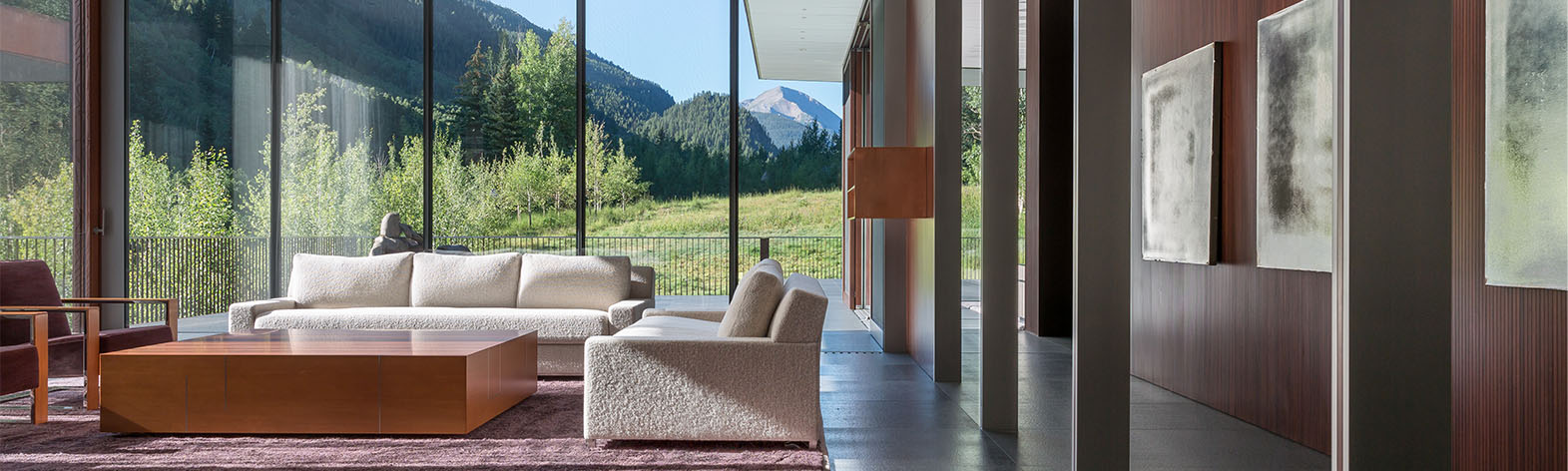 View through window walls of the mountains in a luxury home in Aspen, CO