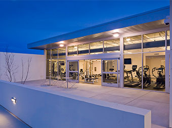 View of the gym from the outside of the Albuquerque Police Station Northwest Command Center with the lights on