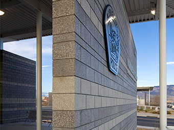 Angled view of the exterior signage on the Albuquerque Police Station Northwest Command Center