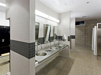 Bathroom with stainless steel fixtures inside of the Albuquerque Police Station Northwest Command Center