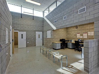 Brick walls and seating area inside of the Albuquerque Police Station Northwest Command Center