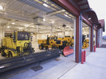 View of the vehicle equipment bays at the Aircraft Rescue and Fire Fight Facility with the doors open