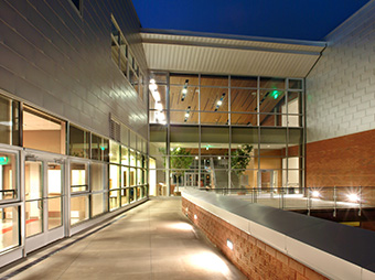 Patio outside of Aspen Middle School at night with interior lights on