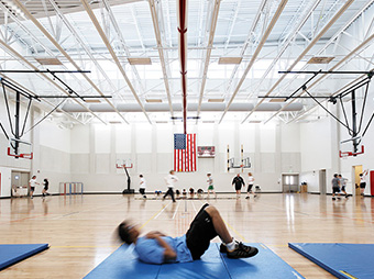 Kids during gym class at Aspen Middle School with American Flag in the background