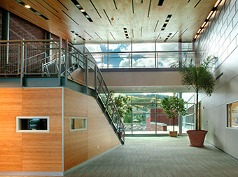 Lobby with lighting and staircase inside of Aspen Middle School