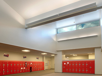 Red lockers in the hallway inside of Aspen Middle School