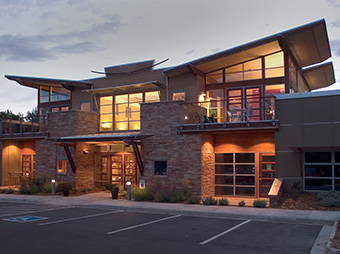Exterior view at dusk of the Burr Oak Design Center with interior lights on