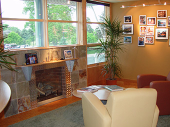 Waiting area with fireplace and seating inside of the Burr Oak Design Center office