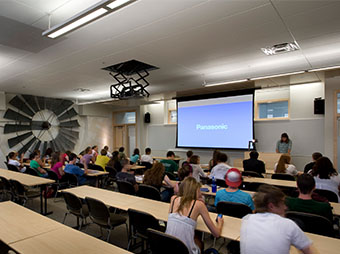 Students listening to a lecture and looking at the projector during class at the Colorado State University Behavioral Science Building in Fort Collins