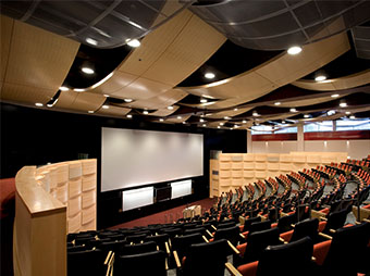 Auditorium with theater style seating and large projector screen inside of the Colorado State University Behavioral Science Building in Fort Collins