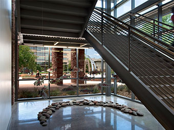 Rocks, glass windows, and a staircase inside of the Colorado State University Behavioral Science Building in Fort Collins
