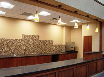 Front desk reception area for patients inside of Christus St. Vincent Hospital