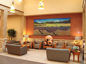 Waiting area with lighting and artwork inside of Christus St. Vincent Hospital