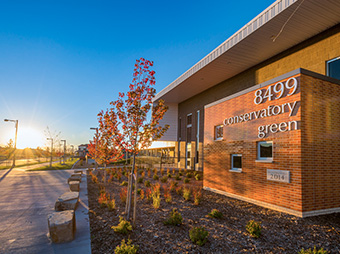 Sunrise at the Conservatory Green School with exterior signage