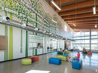 artwork on the walls with lighting and seating inside of Eagle Valley Elementary School