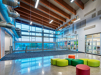 Lobby lights and seating inside of Eagle Valley Elementary School
