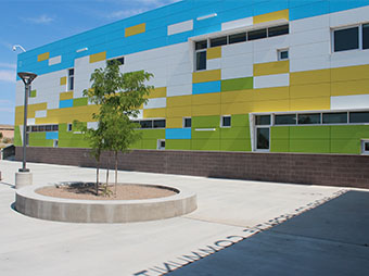 Colorful wall with shadow from exterior signage of the George I. Sanchez Collaborative Community School