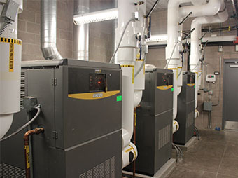 Boilers inside a mechanical room in the George I. Sanchez Collaborative Community School