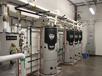 Domestic hot water systems in the mechanical room of the George I. Sanchez Collaborative Community School
