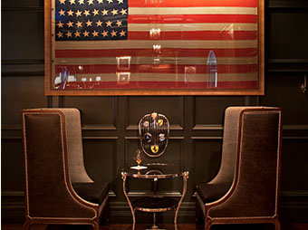 American flag on the wall with seating underneathe at the Hotel Jerome in Aspen, CO
