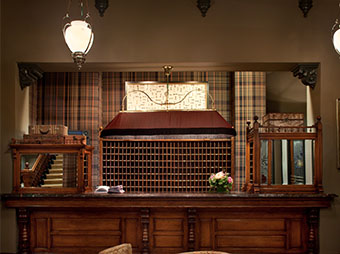 Reception desk inside of the Hotel Jerome in Aspen, CO