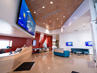 Entryway and integrated television monitors inside of the St. Vrain Valley School District Innovation Center
