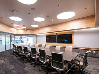 Pitch room lighting, conference table, and microphones inside of St. Vrain Valley School District's Innovation Center