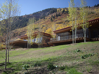 View of the Maroon Ranch luxury home at the top of a hill in Aspen, CO