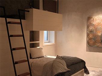 Guest bedroom with loft inside of the Och Residence in Aspen, CO