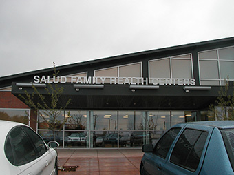 View of exterior signage from the parking lot of the Salud Family Health Center