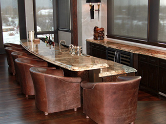 Wet bar and seating area inside of luxury home Snadon Residence