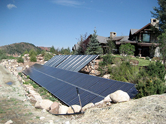 Solar Panels in the rocks outside of the Snadon Residence luxury home