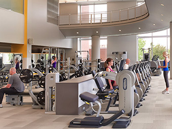 People using the weight room and cardio machines inside of University of Colorado Denver Health and Wellness Center on the Anschutz campus