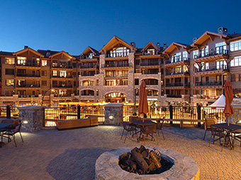 View of the exterior lights and fire pit on the patio of the Northstar Village