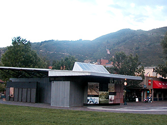 View from a distance of the Wagner Park Edge Pavilion with mountains in the background