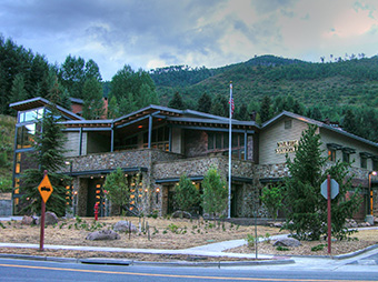 View from Interstate 70 of the West Vail Fire Station #3 at dusk