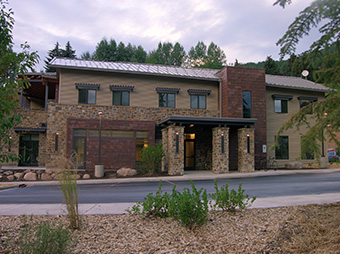 View of the entrance into the West Vail Fire Station #3 with landscaping in the foreground