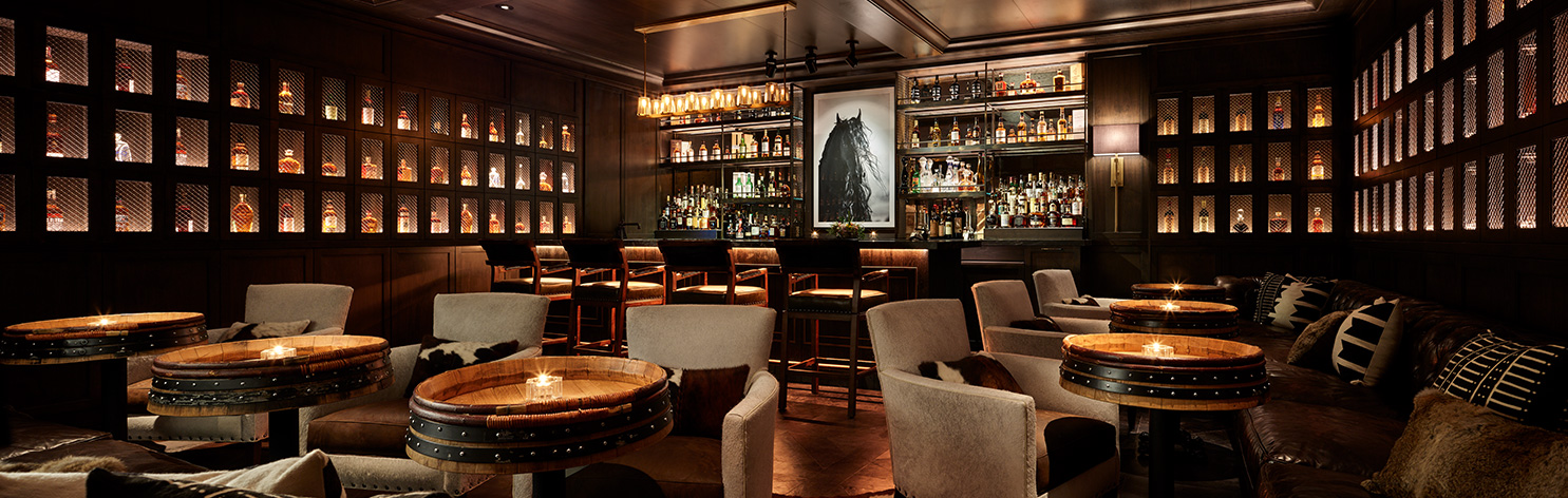 Enlighten Design Studio showcases the bar area at Brush Creek Ranch beautifully