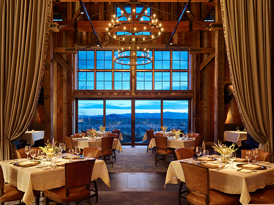 Scenic mountains visible through window in dining room at Brush Creek Ranch