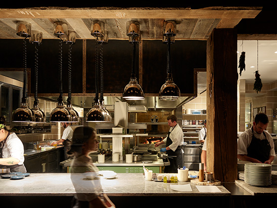 Chefs working in the kitchen of Brush Creek Ranch