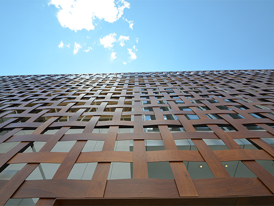 View looking up at the lattice exterior of the Aspen Art Museum where BG provided MEP, Lighting, Technology, Acoustics, and commissioning services