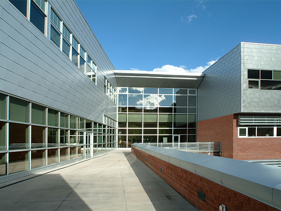 Aspen Middle School pathway to entrance during day where BG provided MEP, lighting, and commissioning services