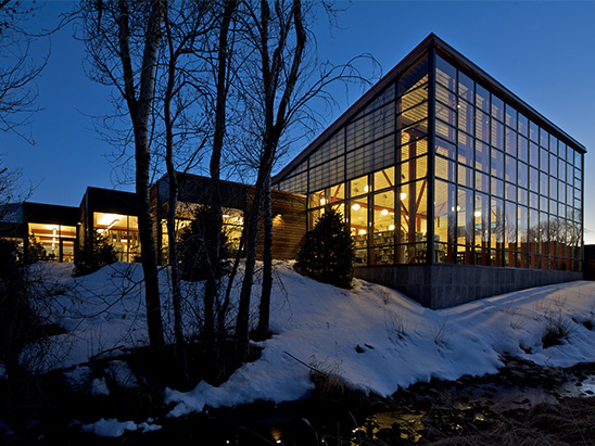 Basalt Library lit up at night with snow on the ground where BG provided MEP, lighting, technology, and commissioning services