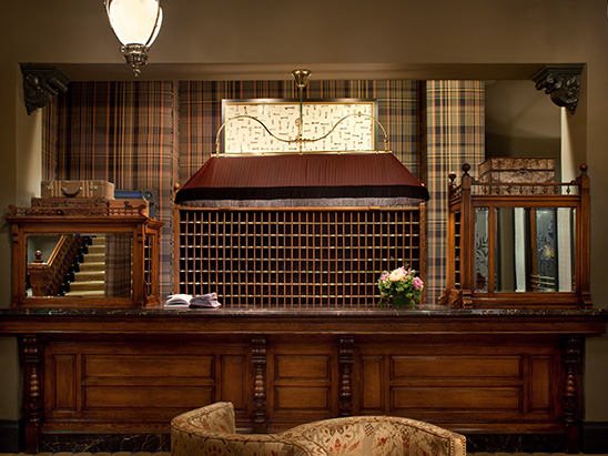 Reception desk at the Hotel Jerome where BG provided MEP, Lighting, and Technology services