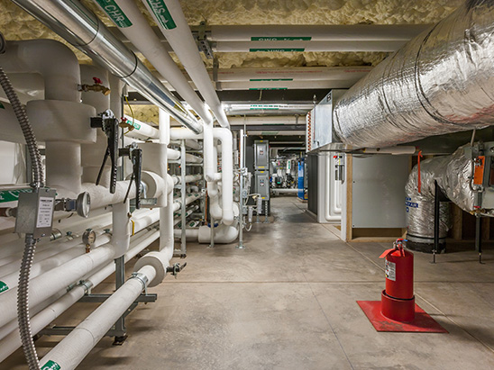 Mechanical room inside of the PT Ranch residence where BG provided MEP, technology, and commissioning services
