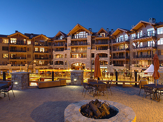 Village at Northstar hotel lit up at night where BG provided MEP, Lighting, commissioning and LEED services